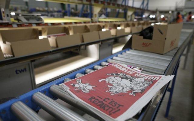 La prochaine édition du Charlie Hebdo qui sortira dans les kiosques le 25 février 2015 (Crédit :  AFP PHOTO/KENZO TRIBOUILLARD )