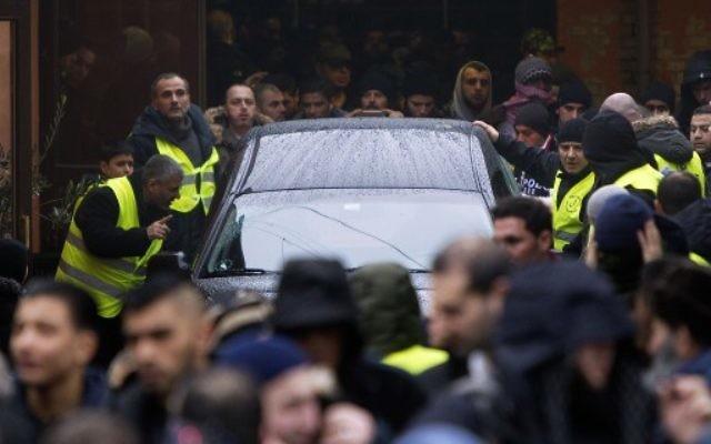 500 personnes à l'enterrement du terroriste de Copenhague (Crédit : NILS MEILVANG / SCANPIX DENMARK / AFP)