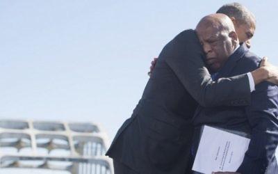 Le président Barack Obama, et John Lewis, militant Afro-américain et homme politique démocrate, à Selma, le 7 mars 2015, lors de la célébration du 50e anniversaire de la grande marche pour les droits civiques (photo credit: AFP PHOTO / SAUL LOEB).