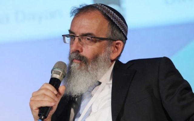 Le rabbin David Stav, cofondateur et président de l'organisation des rabbins Tzohar, lors de la 5e conférence présidentielle annuelle de juin 2013 (Crédit photo : Flash90/file)