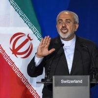 Le ministre iranien des Affaires étrangères Mohammad Javad Zarif pendant une conférence de presse à l'Institut de Lausanne (à l'Ecole Polytechnique Fédérale de Lausanne), le 2 avril 2015. (Crédit : AFP/Fabrice Coffrini)