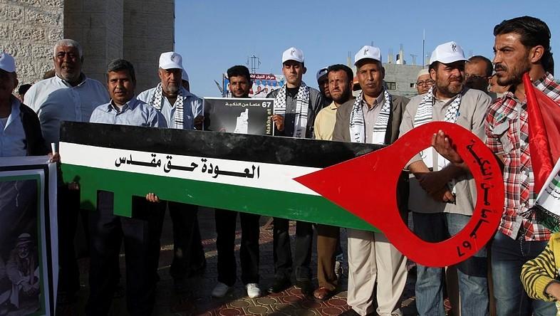 """Les Palestiniens prenant part à un rassemblement pour les commémorations du 67e anniversaire de la """"Nakba"""", à Rafah dans le sud de la bande de Gaza, le 14 mai 2015. (Crédit : Abed Rahim Khatib / Flash90)"""