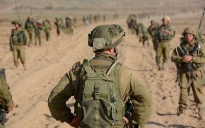 Un officier se préparant à mener ses troupes à Gaza (Crédit : Unité du porte-parole de Tsahal  / Flickr)