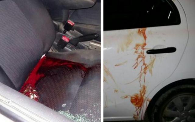 Un véhicule israélien touché par des tirs près de Chvout Rahel, au nord de Ramallah, 30 Juin 2015. (Crédit : Israël Hatzolah)