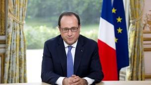 Le président français François Hollande prend la parole lors de l'entretien annuel à la télévision lors de la fête nationale à l'Elysée à Paris le 14 juillet 2015 (Crédit : AFP PHOTO / POOL / ALAIN JOCARD)