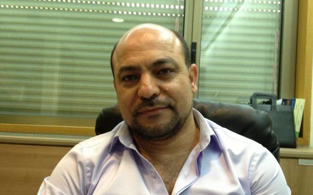 Le député Masud Ganaim de la Liste arabe unie à son bureau de la Knesset, le 10 mars 2014 (Crédit : Elhanan Miller / Times of Israël)