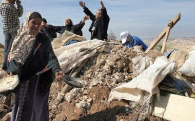 Des Palestiniens de Susya, après la destruction de leur maison en 2011.  (Crédit : Najeh Hashlamoun/Flash90)