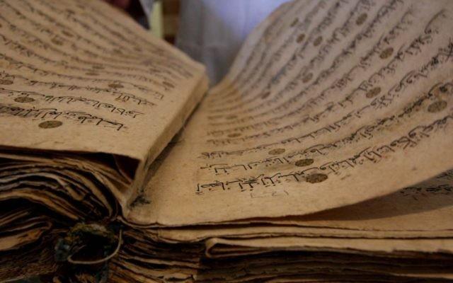Illustration du Coran (Crédit : Issam Rimawi / Flash90)