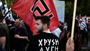 Partisans du parti ultra nationaliste grec Aube dorée. Illustration. (Crédit : Aris Messinis/AFP)