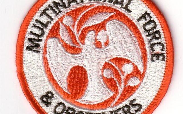 Badge de la Multinational Force and Observers (Crédit  : Domaine public/Wikipédia)