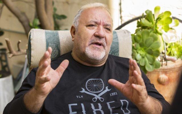 Joel Laloux, l'ancien propriétaire du Bataclan répond aux questions lors d'un entretien avec l'AFP à son domicile à Ashdod, le 18 novembre, 2015. (Crédit : AFP / JACK GUEZ)