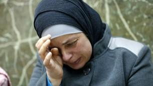 Suha, la mère de l'adolescent palestinien Mohammed Abu Khdeir, qui a été tué l'an dernier, au tribunal de Jérusalem, le 20 décembre 2015 (Photo: AHMAD GHARABLI / AFP)