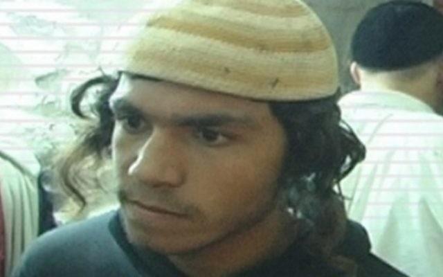 Amiram Ben-Uliel, qui a été inculpé dimanche 3 janvier 2016, pour assassinat dans les meurtres de la famille Dawabsha à Duma (Autorisation)