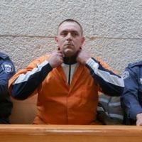 Le meurtrier Roman Zadorov dans la salle d'audience de la Cour suprême, à Jérusalem, le 23 décembre 2015 (Crédit : Gili Yohanan)