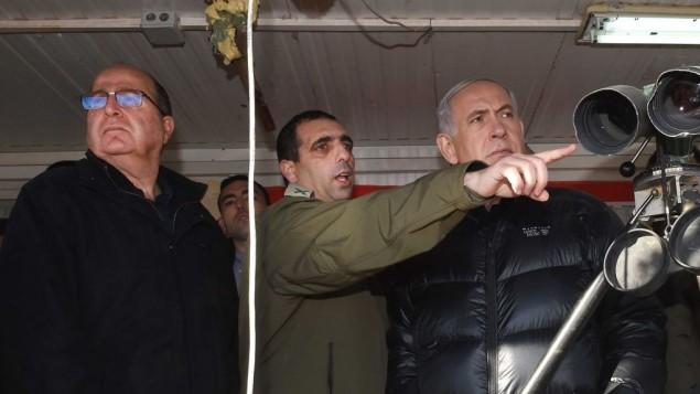 Le Premier ministre Benjamin Netanyahu, à droite, Ofek Buchris, au centre, et le ministre de la Défense Moshe Yaalon au mont Hermon, regardant la frontière israélienne avec la Syrie, le 4 février 2015. (Crédit : Effi Sharir/POOL)