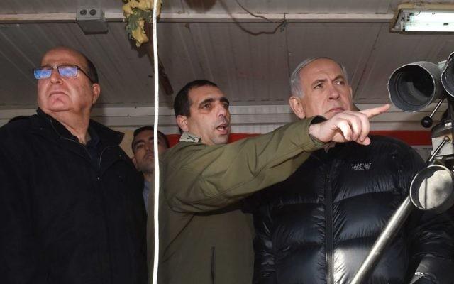 Le Premier ministre Benjamin Netanyahu, à droite, Ofek Bouchris, au centre, et le ministre de la Défense Moshe Yaalon au mont Hermon, regardant la frontière israélienne avec la Syrie, le 4 février 2015. (Crédit : Effi Sharir/Pool)