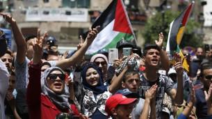 Rassemblement de commémoration de la 68e Nakba, à Ramallah, le 17 mai 2016. (Crédit : AFP PHOTO / ABBAS MOMANI)