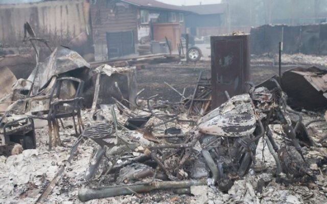 Quartier résidentiel de Fort McMurray après le passage d'un incendie, au Canada, le 7 mai 2016; (Crédit : Scott Olson/Getty Images/AFP)