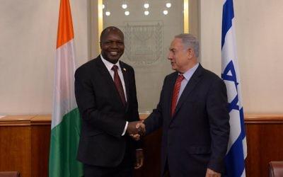Dr. Abdallah Albert Toikeusse Mabri et Benjamin Netanyahu (Crédit : Haim Tzach (GPO))