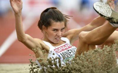 L'athlète israélienne Hanna Knyazyeva-Minenko s'octroie l'argent lors de la finale féminine de triple saut, aux Championnats d'Europe d'athlétisme, à Amsterdam, le 10 juillet 2016. (Crédit AFP/Fabrice Coffrini)