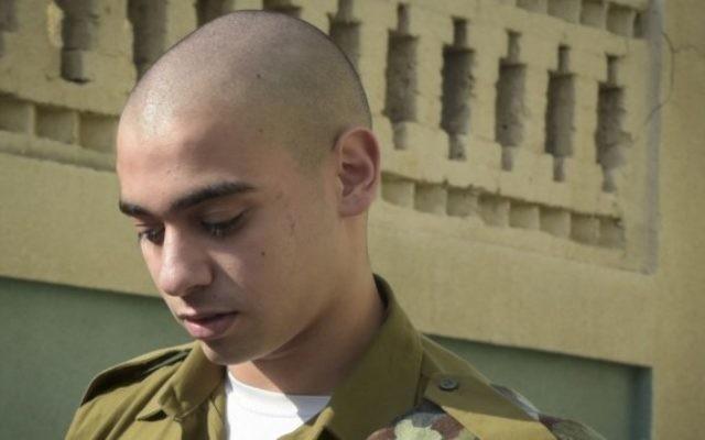 Elor Azaria, un soldat israélien qui a tué un terroriste palestinien déjà neutralisé à Hébron, devant la cour militaire de Jaffa, le 24 juillet 2016. (Crédit : Flash90)