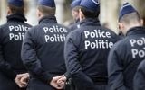 Les agents de police belges montent la garde sur la Grand Place à Bruxelles le 23 mars 2016. (Crédit : AFP / Kenzo Tribouillard)