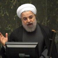 Le président iranien Hassan Rouhani s'exprime devant le parlement après la levée des sanctions par l'accord nucléaire, à Téhéran, le 17 janvier 2016. (Crédit : Atta Kenare/AFP)