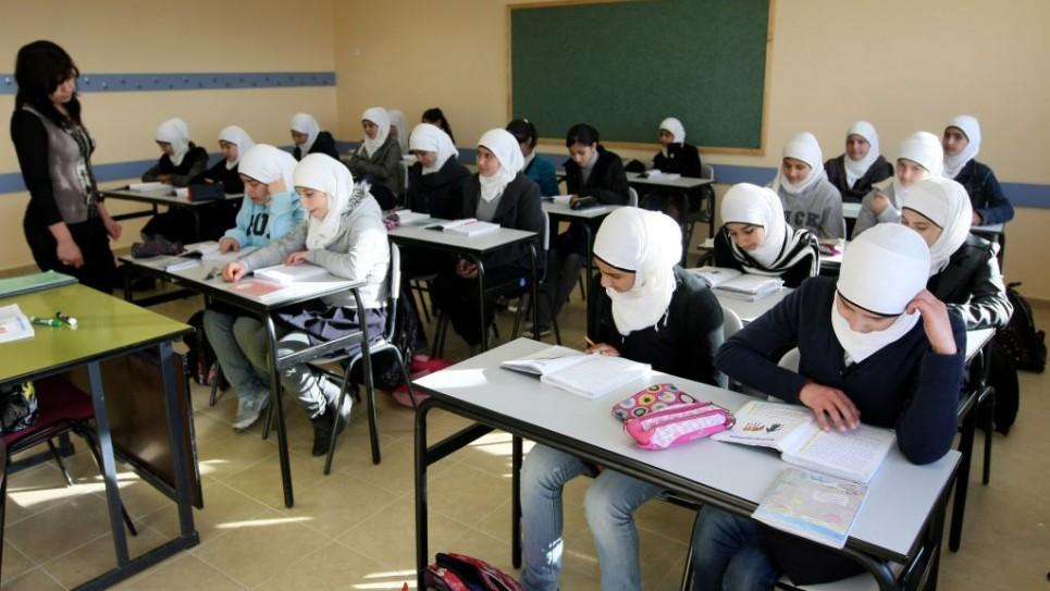 Les jeunes étudiants arabes dans la classe d'une école primaire dans le quartier arabe de Umm Tuba à Jérusalem-Est, le 13 décembre 2011 (Crédit : Flash90 / Kobi Gideon)
