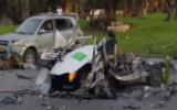Les restes d'une voiture qui a explosée sur un parking de la rue La Guardia de Tel Aviv, tuant un homme, le 16 octobre 2016. L'incident serait lié au crime organisé. (Crédit : capture d'écran Deuxième chaîne)