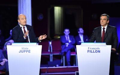 François Fillon (d) et Alain Juppé (g) lors d'un débat le 3 novembre 2016 (Crédit :  AFP / Eric FEFERBERG)