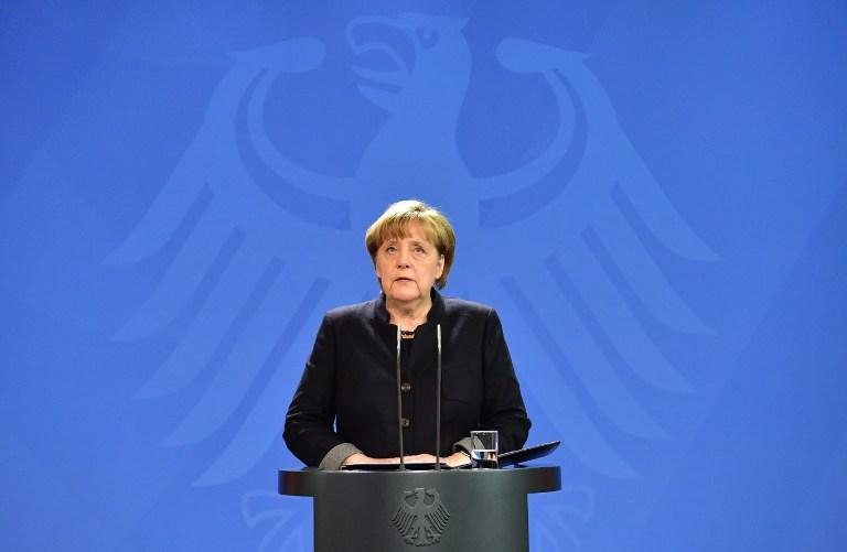 Vingt-quatre heures après l'attaque au camion-bélier qui a fait 12 morts sur un marché de Noël de Berlin, la Chancelière Angela Merkel a tenu une conférence de presse à Berlin le 20 décembre 2016 (Crédit :  AFP/John MACDOUGALL)/ AFP PHOTO / John MACDOUGALL