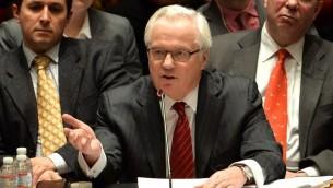 Vitaly Churkin, ambassadeur russe aux Nations unies, devant le Conseil de sécurité, à New York, le 19 mars 2014. (Crédit : Stan Honda/AFP)