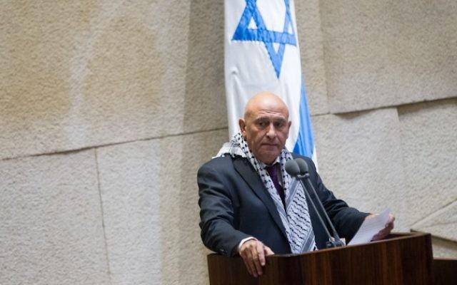 Basel Ghattas, député de la Liste arabe unie, s'adresse à la Knesset, le 26 novembre 2014. (Crédit : Miriam Alster/Flash90)