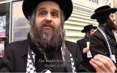 Le site Slate a suivi  un groupe de Neturei karta en marge de la Conférence de paix de Paris (capture d'écran Youtube/Slate)