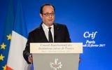 Le président français François Hollande pendant le 32e dîner annuel du CRIF, à Paris, le 22 février 2017. (Crédit : Christophe Petit Tesson/Pool/AFP)