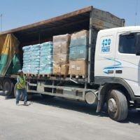 Un camion chargé d'aide humanitaire turque entre dans la bande de Gaza par le poste-frontière de Kerem Shalom, le 4 juillet 2016. (Crédit : ministère de la Défense)