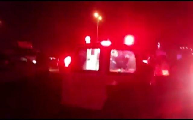 Scène d'un double homicide dans la zone industrielle de Kafr Qassem, le 5 février 2017. (Crédit : capture d'écran YouTube)