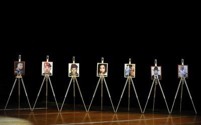 Les portraits des sept victimes de Mohamed Merah pendant une cérémonie de commémoration organisée par le CRIF à Toulouse, le 19 mars 2014. (Crédit : Rémy Gabalda/AFP)