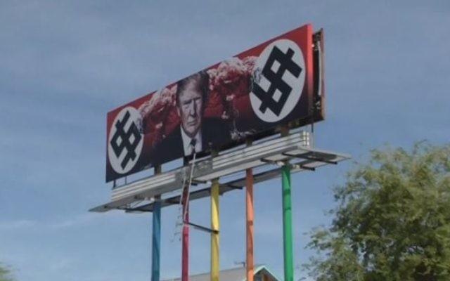 Une affiche créée par une artiste représentant le président américain Donald Trump avec des dollars en forme de croix gammée et des champignons nucléaires à Phoenix, Arizona, le 18 mars 2017. (Crédit : capture d'écran Reuters)