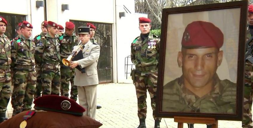 Hommage rendu à Lyon à Mohamed Legouad (portrait), victime de Mohamed Merah, en mars 2012. (Crédit : capture d'écran Dailymotion/Le Progrès)