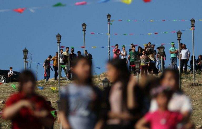 Cérémonie du Nouvel an de la communauté yazidie irakienne, à Bashiqa, près de Mossoul, le 19 avril 2017. (Crédit : Safin Hamed/AFP)