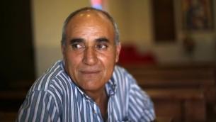 Assaf Adib, 57 ans, lors d'une interview sur les Chrétiens dans le village druze d'Ein Qiniye dans le plateau du Golan, le 11 juin 2017 (Crédit : AFP PHOTO / JALAA MAREY)