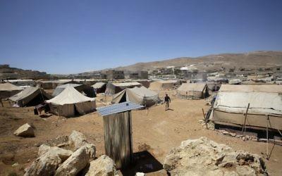 Camp de réfugiés syriens d'Arsaal, au Liban, le 14 juin 2013. Illustration. (Crédit : Joseph Eid/AFP)