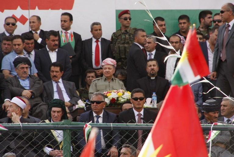 Massoud Barzani, au centre, président de la région autonome du Kurdistan irakien, pendant un rassemblement de soutien au référendum sur l'indépendance du Kurdistan, à Sulaimaniya, le 20 septembre 2017. (Crédit : Shwan Mohammed/AFP)