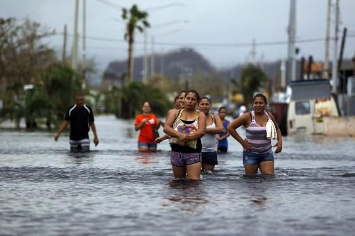 Les rues inondées après l'ouragan Maria à San Juan, la capitale de Puerto Rico, le 22 septembre 2017. (Crédit : Ricardo Arduengo/AFP)