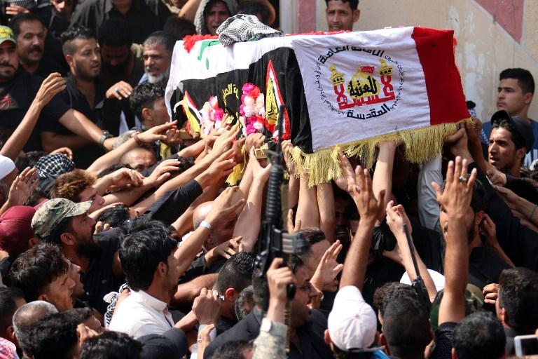Funérailles d'Abou Tahsin al-Salhi, sniper des unités Hashed al-Shaabi, qui a tué au moins 320 combattants de l'Etat islamique, à Basra, le 30 septembre 2017. (Crédit : Haidar Mohammed Ali/AFP)