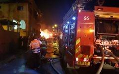 Les pompiers et les secouristes sur le site d'une explosion et l'effondrement d'un bâtiment à Jaffa, le 27 novembre 2017 (Crédit : Magen David Adom)