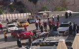 Des Ferrari garées devant le mur Occidental, le 5 novembre 2017 (Crédit : capture d'écran YouTube)