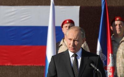 Le président russe Vladimir Poutine en Syrie, le 11 décembre 2017. (Crédit : AFP/POOL/Mikhail KLIMENTYEV)