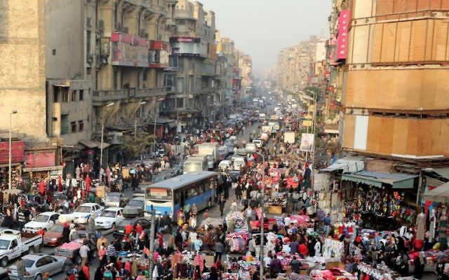 A picture taken on December 12, 2017 shows an elevated view of al-Attaba district on the edge of downtown Cairo, Egypt. Egypt is the most populated coutry in the Arab world with some 96 million inhabitants and the numbers are rising by 1.6 million every year.  / AFP PHOTO / MOHAMED EL-SHAHED
